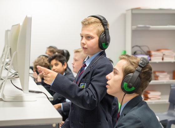 Boys viewing computer