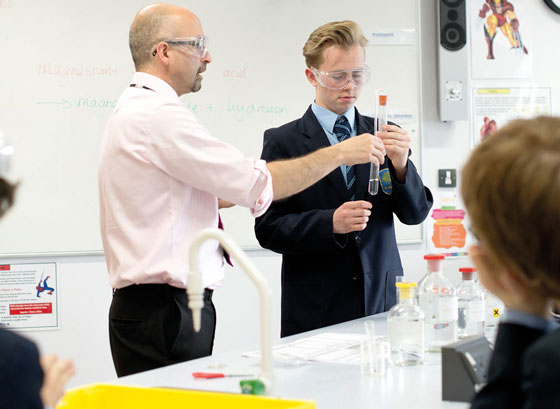 Science lesson boy with test tube